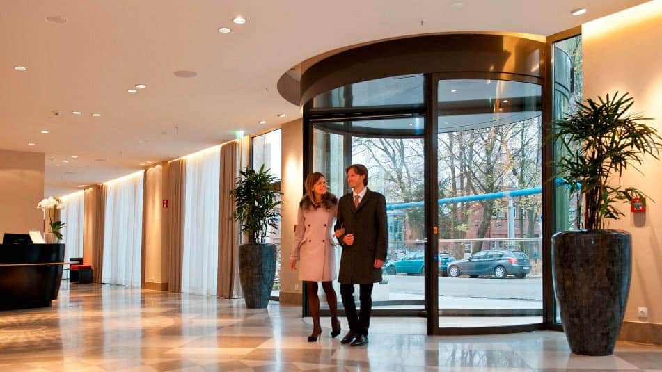 Our revolving doors combine high-quality materials flexible operation and good durability. They make people flow smoother and can influence energy costs. & Automatic Revolving Doors - KONE