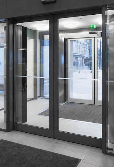 Dark KONE automatic sliding doors at Aava health service centre. & KONE Automatic Sliding Doors